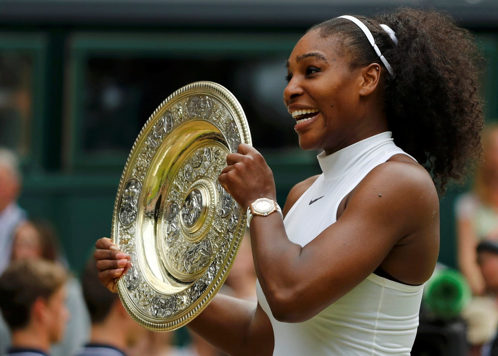 Serena Williams celebrates winning her Womenu2019s singles final match against Germany's Angelique Kerber with the trophy, Wimbledon, Britain. (Reuters Photo)