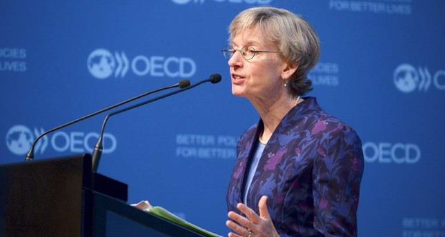 OECD Chief Economist Catherine Mann presents the OECD interim economic outlook Global growth warning: weak trade, financial distortions at the OECD headquarters in Paris.