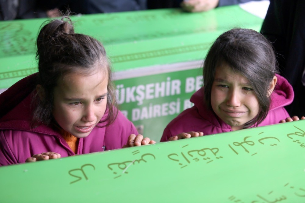 Friends and sisters of victims cried beside their coffins.