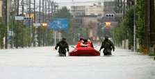 50 dead in Japan floods as rescuers 'race against time'