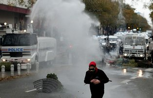 Police in Paris fire water cannons at protesters