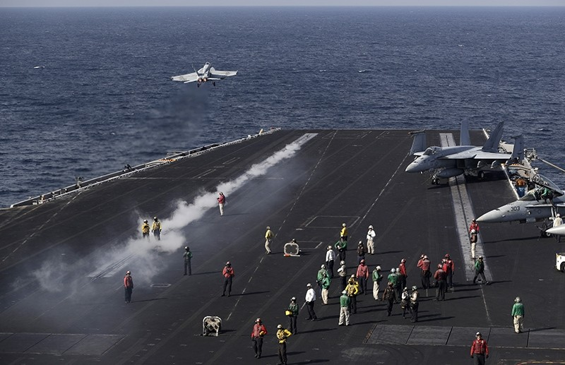 In this picture taken on Monday, Nov. 21, 2016, a U.S. Navy fighter jet takes off from the deck of the U.S.S. Dwight D. Eisenhower aircraft carrier (AP Photo)