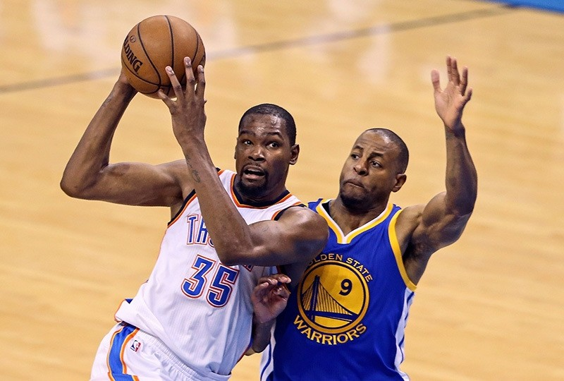 Former OKC Thunder forward Kevin Durant drives to the basket as Warriors forward Andre Iguodala (9) defends during Game 4 of the Western conference finals of the NBA Playoffs at Chesapeake Energy Arena, May 24, 2016; Oklahoma City (Reuters Photo)