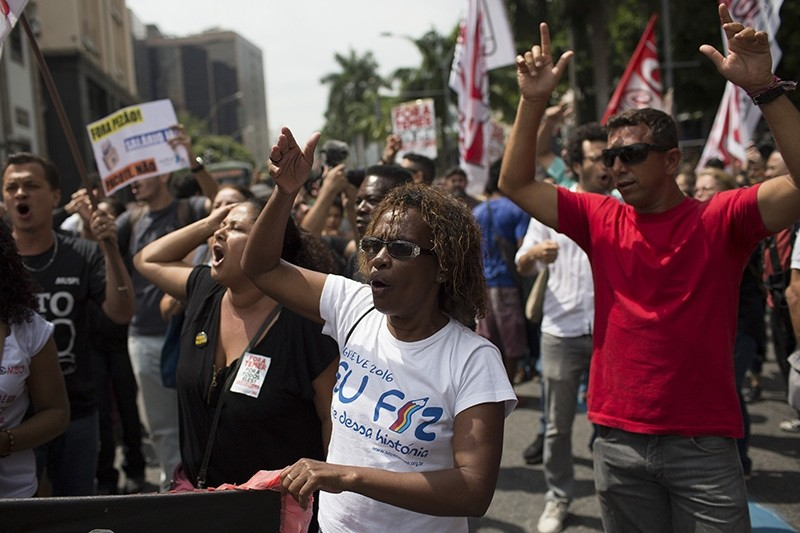 Demonstrators shout slogans during a protest outside the state of Rio de Janeiro's legislative assembly building, where lawmakers are discussing austerity measures in Rio de Janeiro, Brazil, Nov. 22, 2016. (AP Photo)