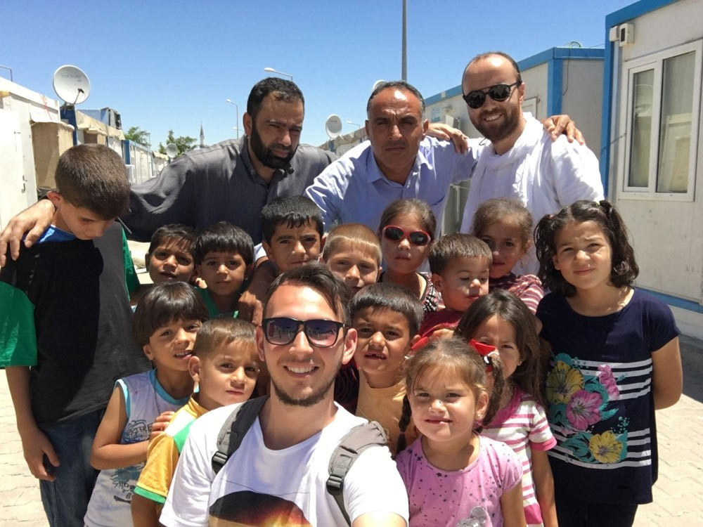 Daily Sabahu2019s Yunus Paksoy with Syrian children at the Harran refugee camp.