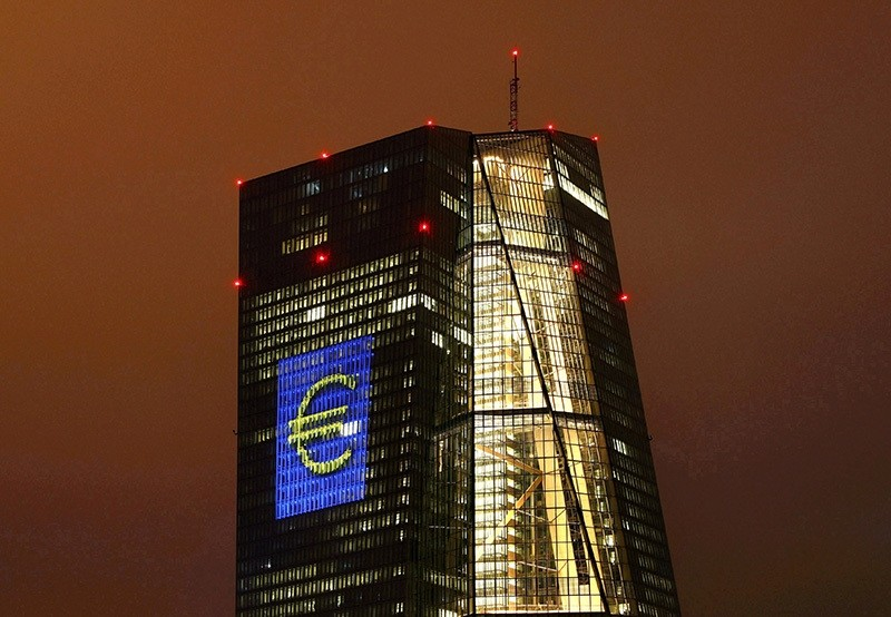 The headquarters of the European Central Bank (ECB) are illuminated with a giant euro sign at the start of the ,Luminale, light and building, event in Frankfurt, Germany, March 12, 2016. (Reuters Photo)