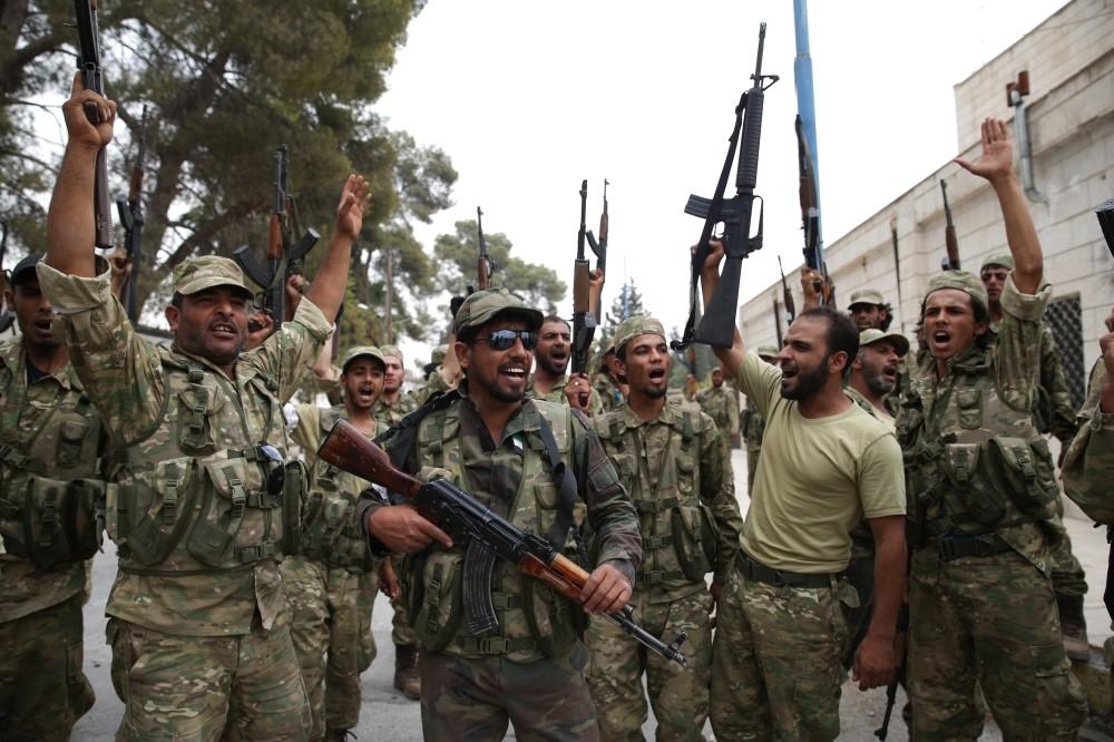 Turkey-backed FSA fighters jubilant after liberating Jarablus from DAESH terrorists.