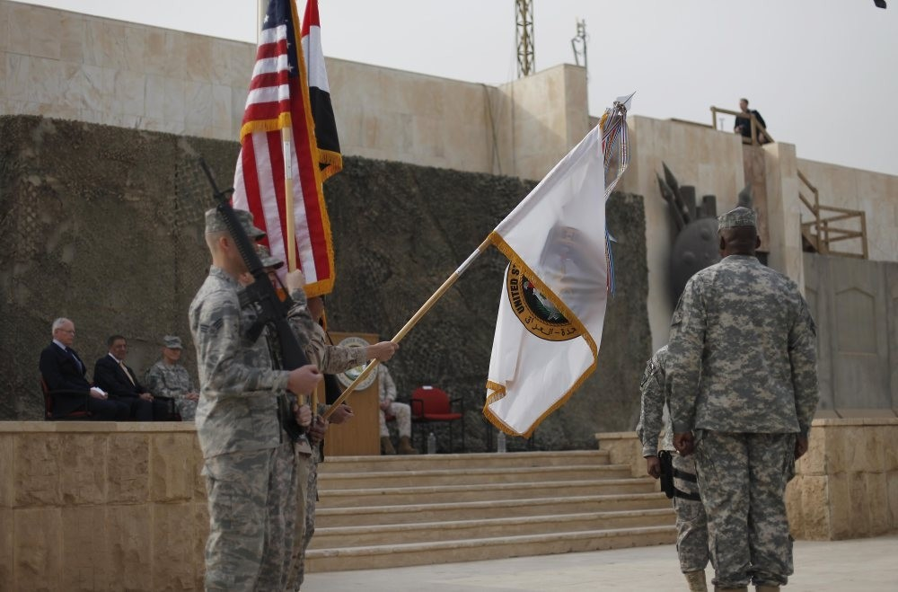 U.S. Secretary of Defense Leon Panetta, second from the left, and Ambassador to Iraq James Jeffrey, far left, at the U.S. Forces-Iraq colors casing ceremony, Baghdad, Iraq, Dec. 15, 2011.