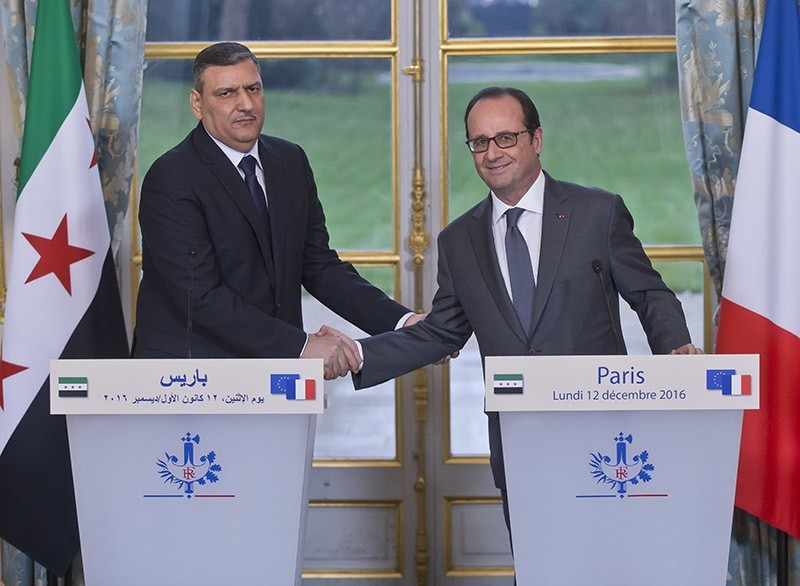 Chief Negotiator for the Syrian Opposition Riyad Hijab, left, and French President Francois Hollande shake hands during a joint media conference at the Elysu00e9e Palace in Paris on Dec. 12, 2016. (AP Photo)