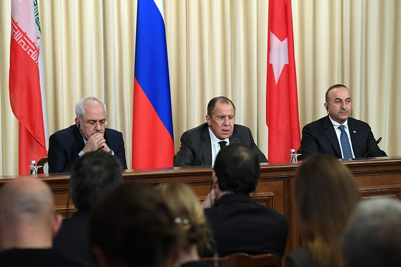 Iranian Foreign Minister Mohammad Javad Zarif, Russian Foreign Minister Sergei Lavrov and Turkish Foreign Minister Mevlut Cavusoglu attend a press conference in Moscow, Russia, 20 December 2016. (EPA Photo)