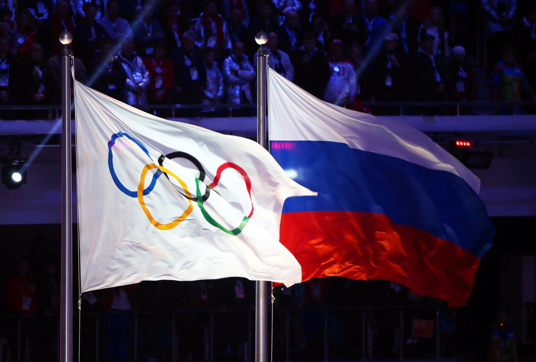 A file picture dated 23 February 2014 of the Olympic flag (L) and the Russian flag (R) during the Closing Ceremony of the Sochi 2014 Olympic Games in the Fisht Olympic Stadium in Sochi, Russia. (EPA Photo)