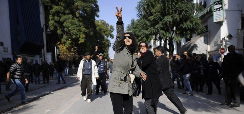 TUNISIANS PROTEST ACTIVISTS ARREST, DECLINE IN ECONOMY