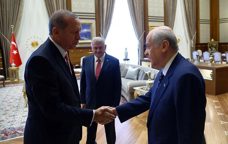 President Recep Tayyip Erdou011fan left, greets Devlet Bahu00e7eli before a meeting in Ankara, Turkey, Monday, July 25 (AP Photo)