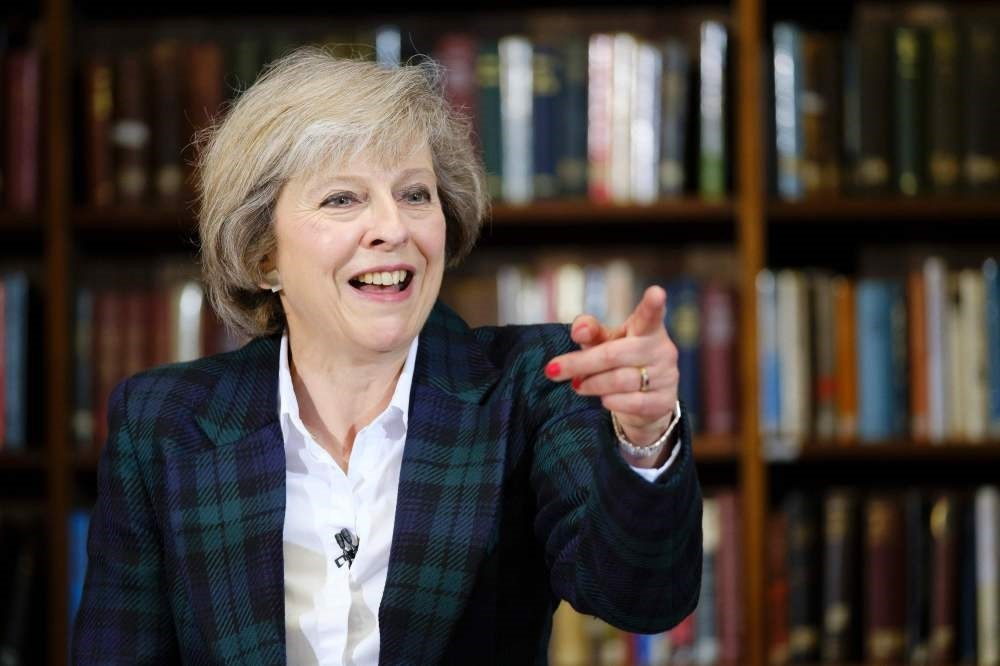 British Interior Minister Theresa May addresses a press conference in central London on June 30.