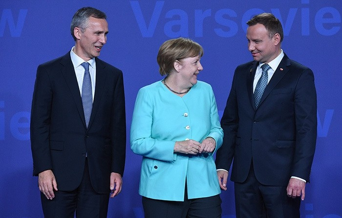 Polish President Andrzej Duda (R) and NATO Secretary General Jens Stoltenberg (L) welcome German Chancellor Angela Merkel (C) at the opening of the NATO Summit at the National Stadium in Warsaw, Poland, 08 July 2016. (EPA Photo)