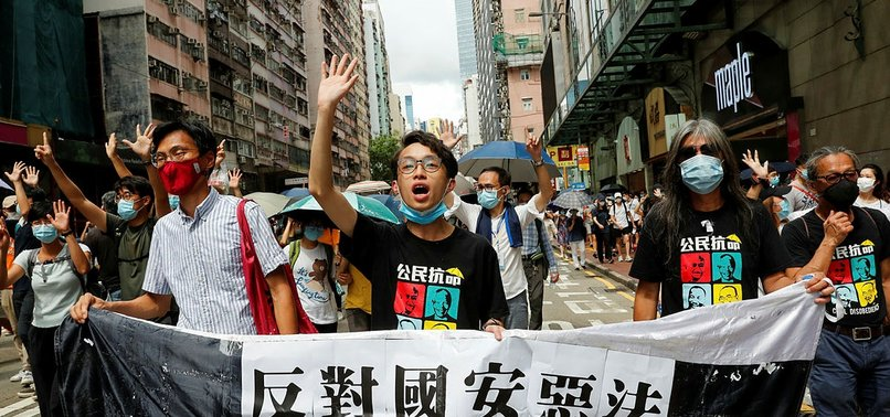 LIBERATE HONG KONG, REVOLUTION OF OUR TIMES SLOGAN IS ILLEGAL, GOVERNMENT SAYS