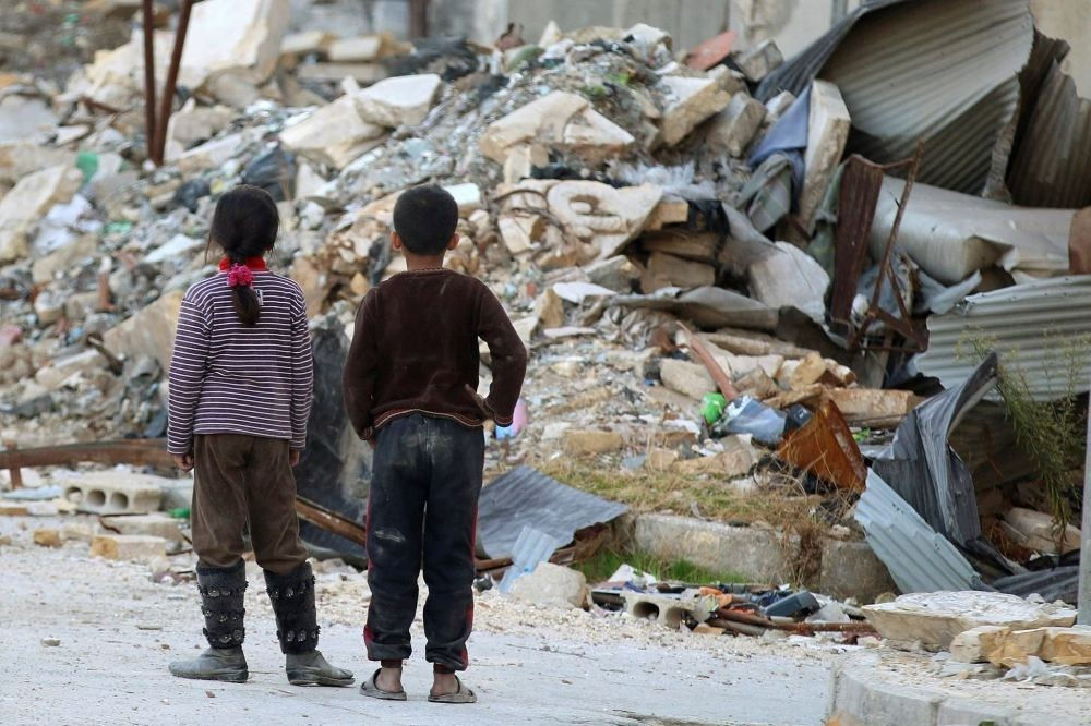 Children inspect the  rubble of damaged buildings in an opposition-held besieged area in Aleppo, Syria, Nov. 6.
