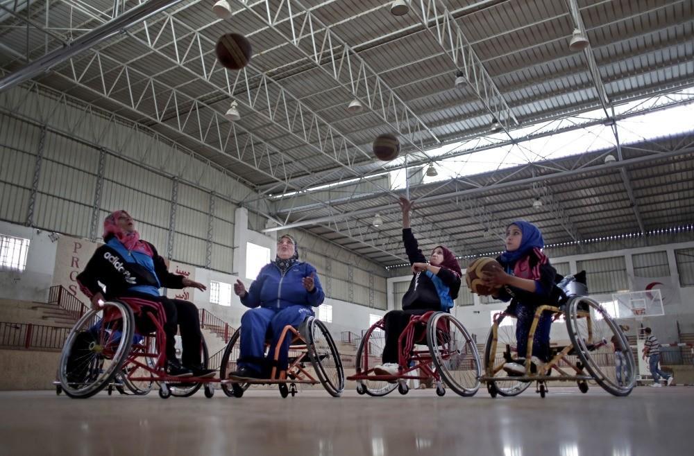 Disabled Palestinian women take part in a basketball training session held by top U.S. coach Jess Markt in the Khan Younis refugee camp, southern Gaza Strip.