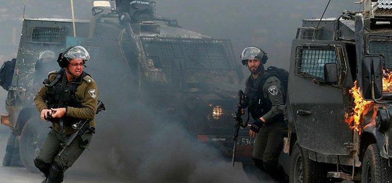ISRAELI ARMY DETAINS 13 PALESTINIANS IN WEST BANK RAIDS