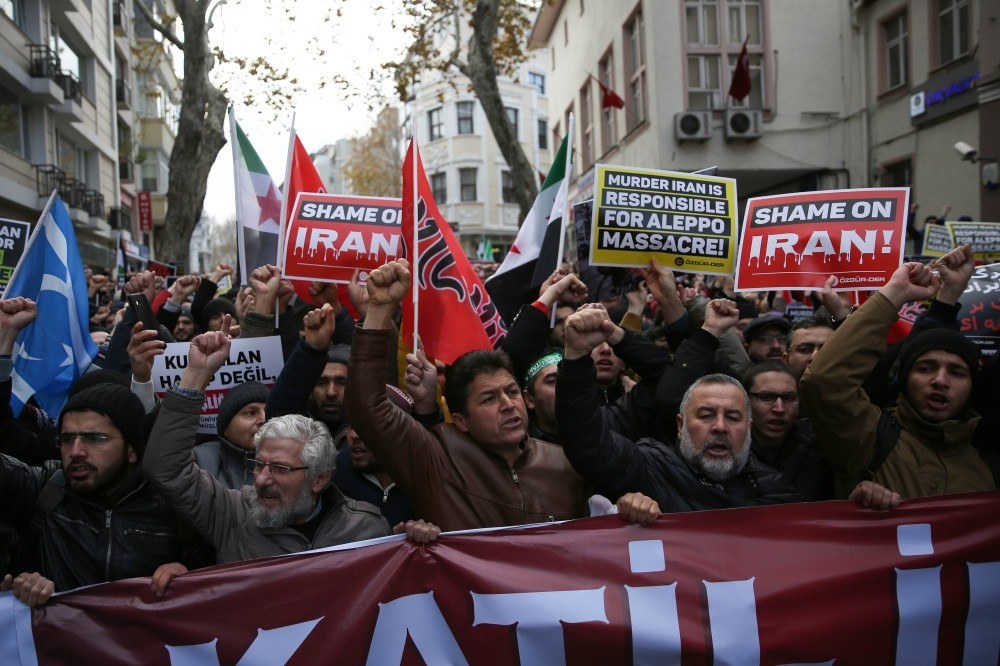 Activists staged a protest outside the Iranian consulate, denouncing it as ,murderer,.