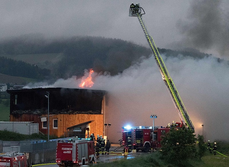 Firemen extinguish fires at a building for asylum seekers, in Altenfelden, northern Austria, on June 01, 2016. (AFP Photo)