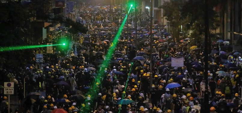 HONG KONG POLICE FIRE TEAR GAS, ROLL OUT WATER CANNON TRUCKS