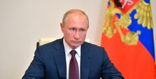 Putin signs law paving way for 16 more years in power