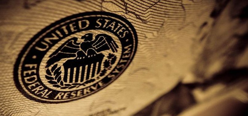 FED HOLDS RATES STEADY BUT HINTS AT FUTURE CUTS