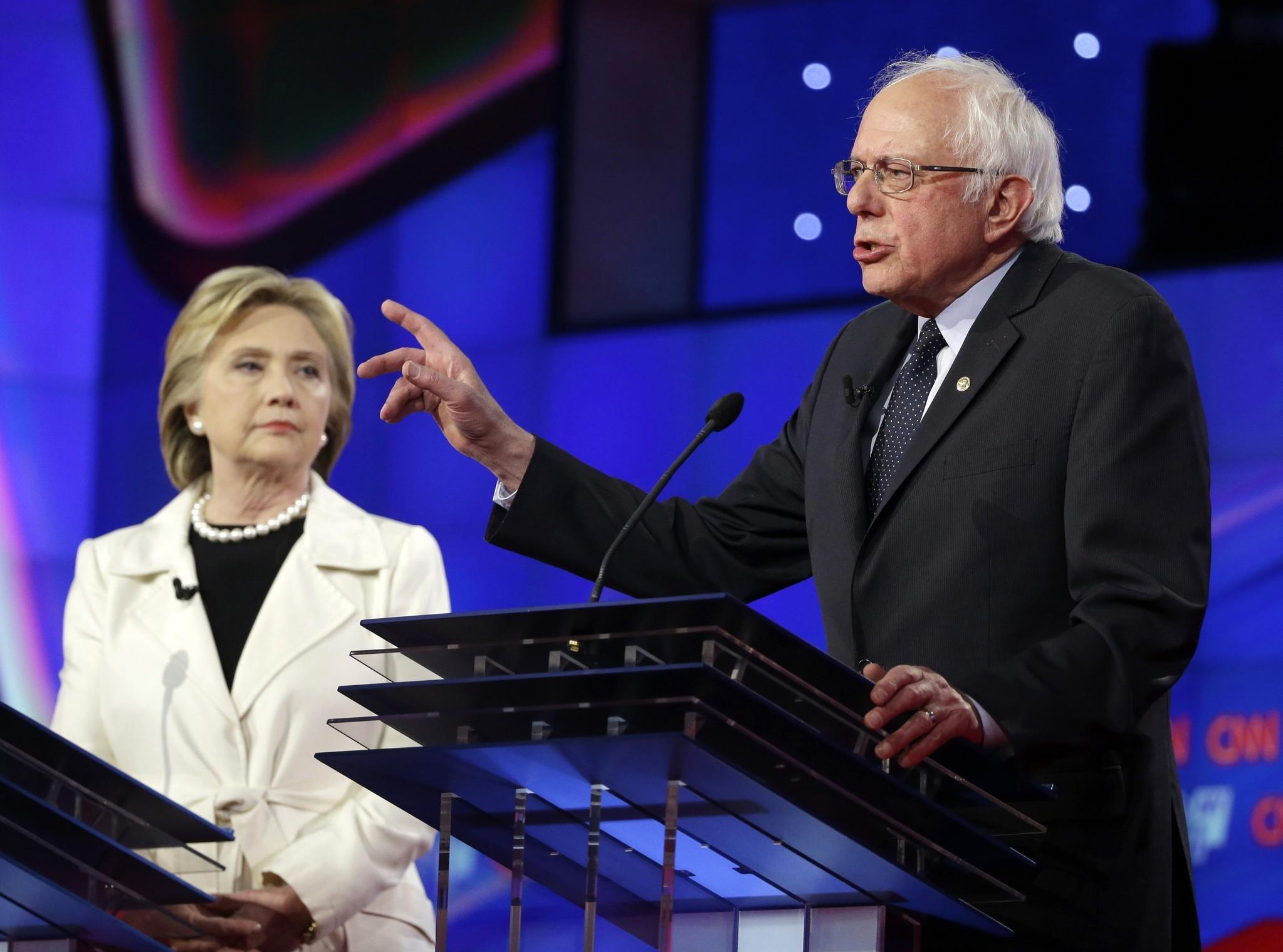 Sen. Bernie Sanders, I-V.t, right, speaks as Hillary Clinton listens during the CNN Democratic Presidential Primary Debate at the Brooklyn Navy Yard in New York. (AP Photo)