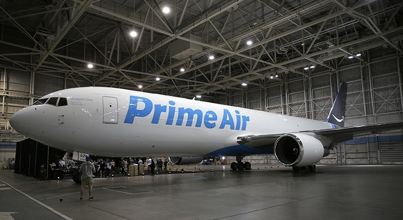 A Boeing 767, an Amazon.com ,Prime Air, cargo plane is parked on display Thursday, Aug. 4, 2016, in a Boeing hangar in Seattle. (AP Photo)