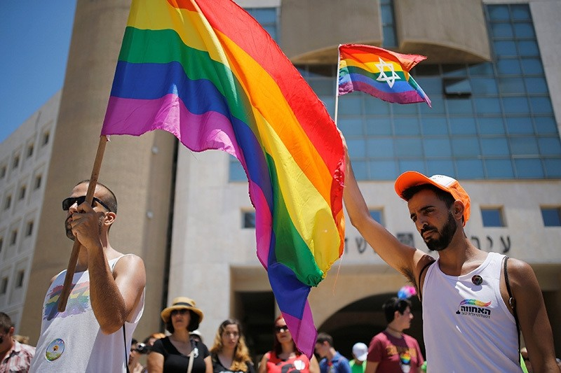 Revelers observe a minute's silence in memory of the victims of the Pulse gay nightclub shooting in Orlando, Florida, during a gay pride parade in the southern city of Ashdod, Israel, June 17, 2016. (Reuters Photo)