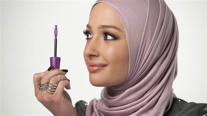 In this undated photo provided by CoverGirl, beauty blogger Nura Afia poses for a photo. (CoverGirl via AP)