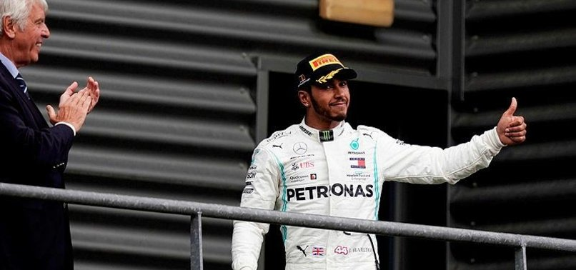 HAMILTON SAYS FERRARI COULD BE AN OPTION BUT LOYALTY IS KEY