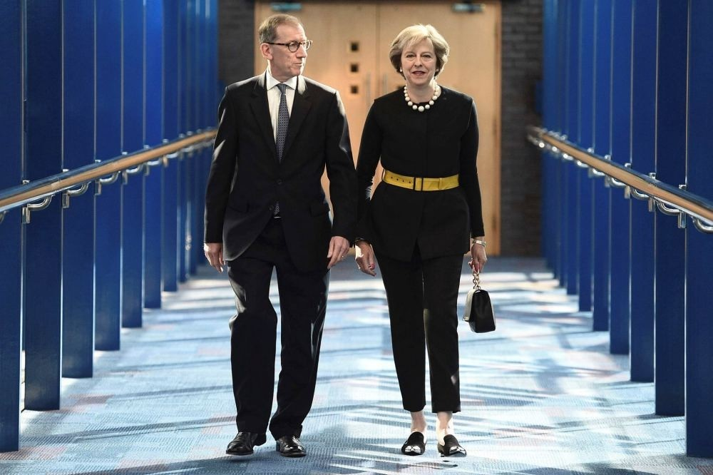 British Prime Minister Theresa May and her husband Philip John May walk along the bridge from the hotel to the International Convention Centre in Birmingham, central England, on Oct. 2 on the first day of the Conservative party annual conference.
