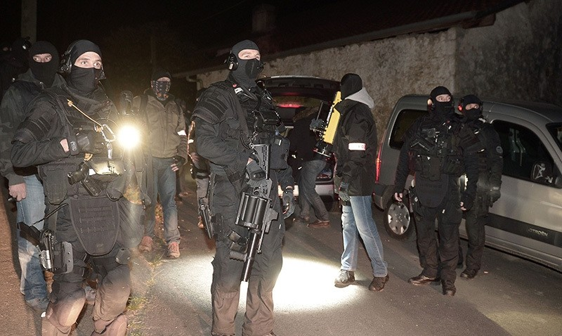 French police officers stand guard after a French and Spanish police operation against the Basque separatist group ETA in Louhossoa (AFP Photo)