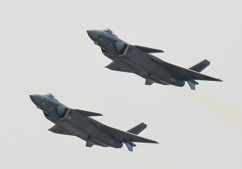 A pair of J-20 stealth fighter jets fly at the China's International Aviation and Aerospace Exhibition in Zhuhai, China's Guangdong province, Tuesday, Nov. 1, 2016. (AP Photo)