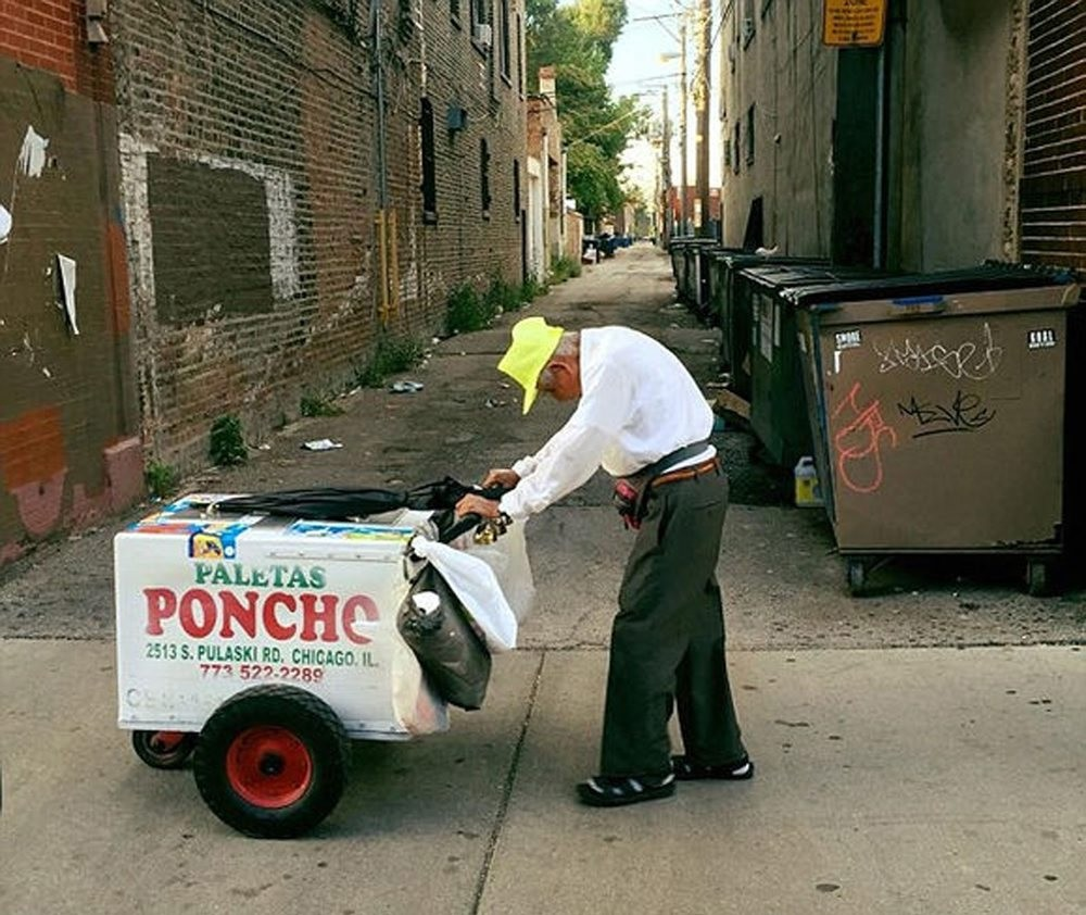 Fidencio Sanchez pushes his cart down the street, Monday, Sept.12, 2016, in Chicago