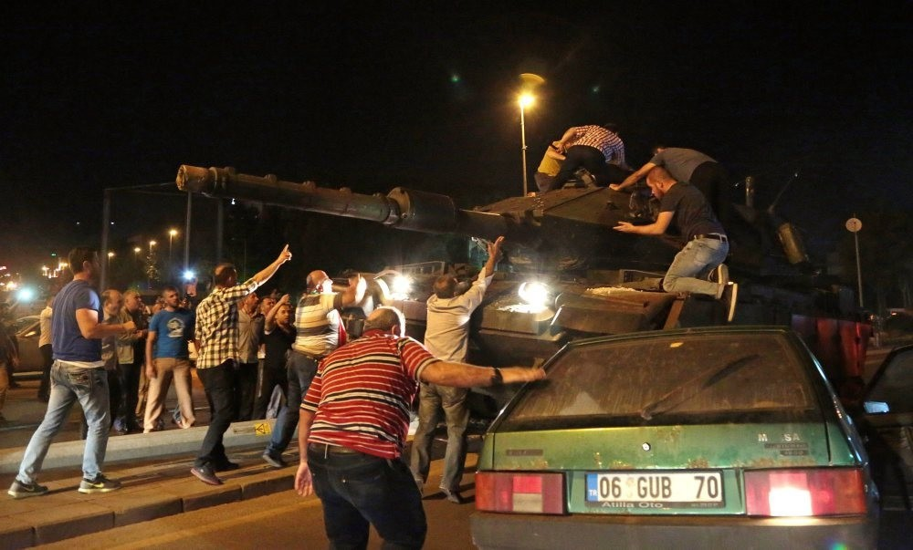 Civilians try to stop tanks commanded by pro-coup troops on July 15 in the capital Ankara.