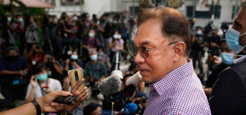 MALAYSIAS ANWAR SAYS FACING MALICIOUS PROBE ON LIST OF BACKERS FOR PM BID