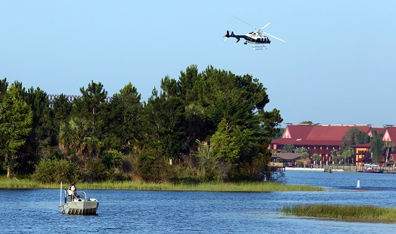 Florida Fish and Wildlife and an Orange County Sheriffs helicopter search for a young boy early Wednesday, June 15, 2016 (AP Photo)