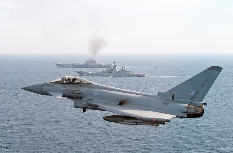 A Royal Air Force Typhoon aircraft joins others and a Royal Navy warship in an operation to escort the Russian Petr Velikiy (C) and the Russian aircraft carrier Admiral Kuznetsov (AFP Photo)