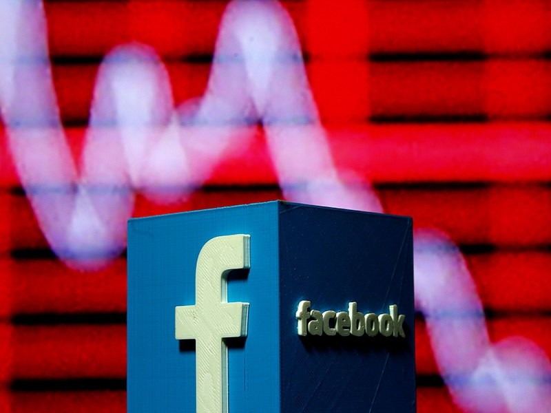 A 3D-printed Facebook logo is seen in front of a displayed stock graph in this illustration taken Nov. 3, 2016. (Reuters)