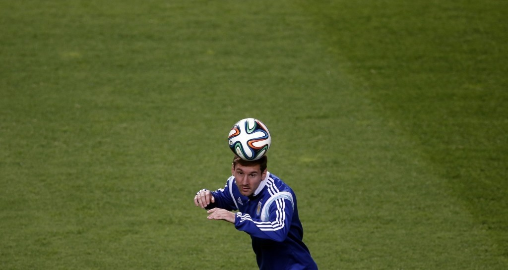 Argentina's Messi heads the ball during a training session in preparation for 2014 World Cup. (REUTERS Photo)