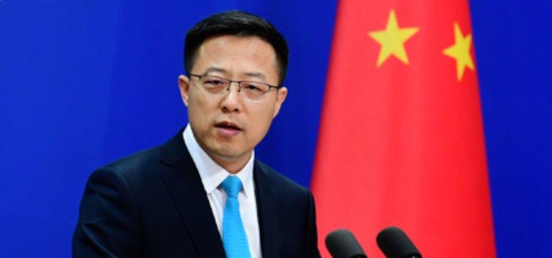 CHINA URGES UK TO REVOKE ENVOYS PARLIAMENT BAN