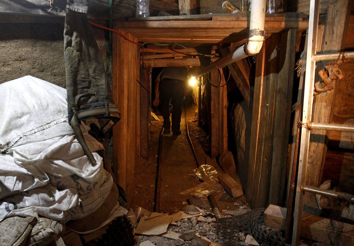 US Border Patrol agent inspects an underground tunnel found near the Morley Gate Border Station at the US-Mexico border in Nogales, Arizona.