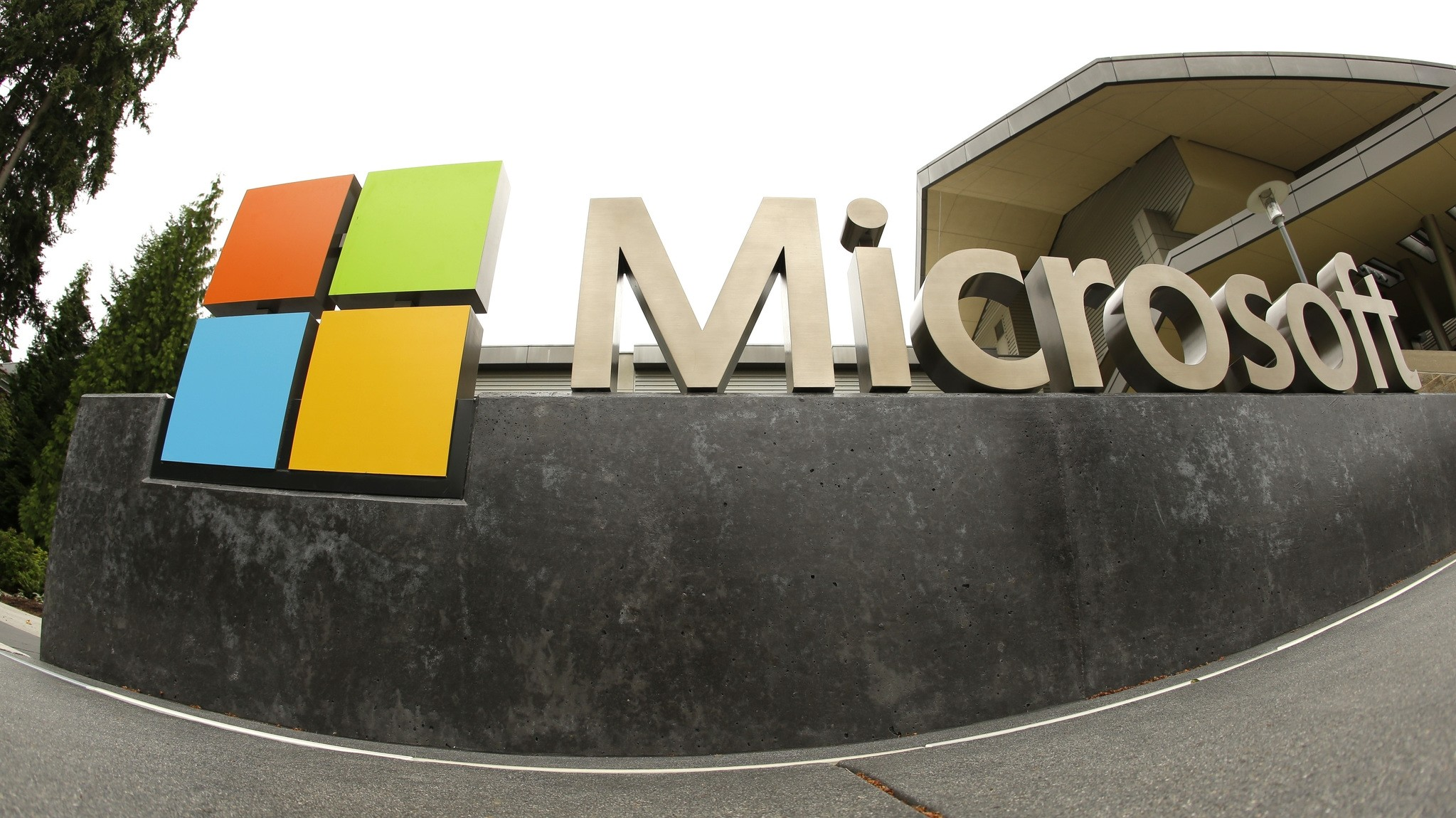 This July 3, 2014, file photo, shows the Microsoft Corp. logo outside the Microsoft Visitor Center in Redmond, Wash. Silicon Valley. (AP Photo)