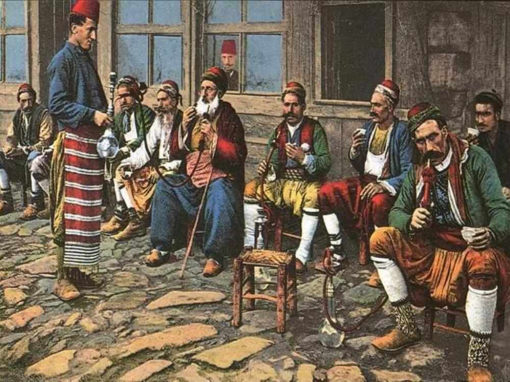 A group of men enjoying hookah at a local Ottoman-era coffeehouse.