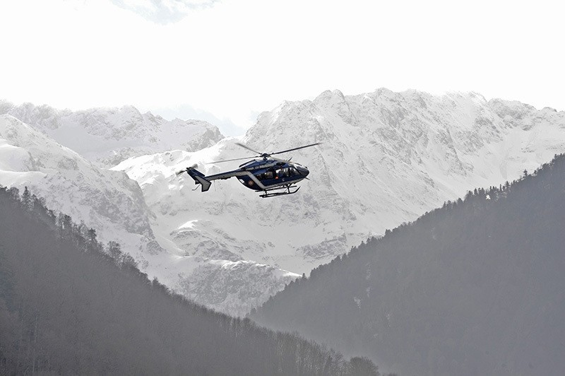 This file photo taken on February 23, 2016 shows members of the high mountain gendarmerie squad (PGHM) arriving by helicopter to airlift an injured person during an exercise in Bagneres-de-Luchon, southwestern France. (AFP Photo)