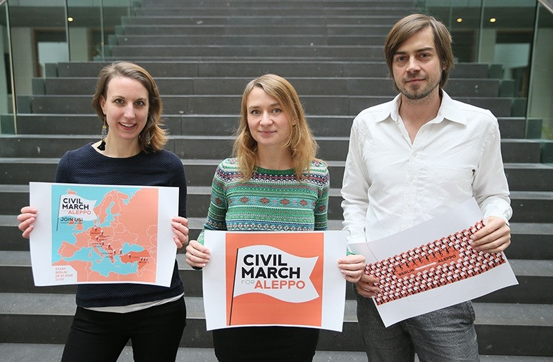 Polish blogger and journalist Anna Alboth (C) and the Civil March for Aleppo movementu2019s members of Thomas Alboth (R) and Jagoda Wozniak-Geier (L) (AA Photo)
