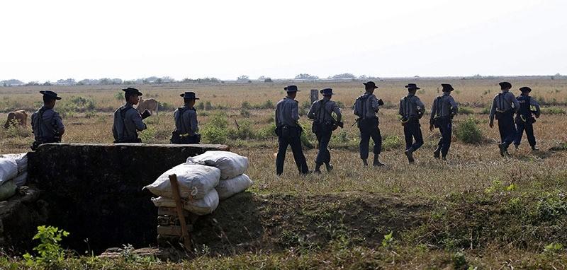 Myanmar police patrol near KoeTanKauk Border Guard Police post around the villages near the Maungdaw town of Bangladesh-Myanmar border, Rakhine State, western Myanmar, 22 December 2016. (EPA Photo)